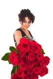 Rote Rosen und Valentinsgrußkleid Stockfotografie