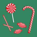 Rote Süßigkeit auf grünem Hintergrund Stockfoto