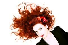 Rote schöne Hauptfrau Lizenzfreies Stockfoto