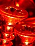 Rote Schraube Lizenzfreies Stockfoto