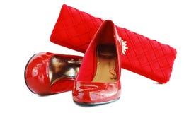 Rote Schuhe der Dame und Frauenbeutel Lizenzfreie Stockfotos
