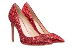 Rote Schuhe der Frauen mit Funkeln Stockfotos