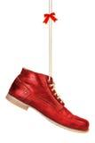 Rote Schuhe mit einem Bogen Lizenzfreie Stockfotografie