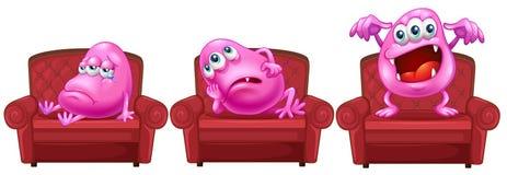Rote Stühle mit rosa Monstern Stockbilder