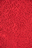 Rote Stoffmatte Stockfotografie