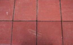 Rote Straßendecke stockfotos