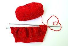 Rote Strickjacke des Knit mit Liebe Stockfotografie