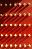 Rote Tür und Nägel Stockfotos