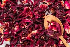 Rote Teehintergrundbeschaffenheit Hölzerner Löffel Lizenzfreie Stockfotos