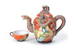 Rote Teekanne mit Cup. Lizenzfreies Stockbild