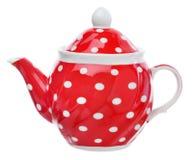 Rote Teekanne mit weißen Tupfen Stockfoto