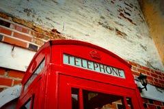 Rote Telefonzelle durch CU Stockbild