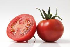 Rote Tomate auf einem weißen Hintergrund Lizenzfreies Stockbild