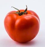 Rote Tomate auf einem weißen Hintergrund stockfotos