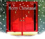 Rote Tür-frohe Weihnachten Stockfotografie