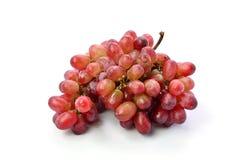 Rote Trauben getrennt auf weißem Hintergrund Stockfotos