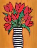 Rote Tulpen in gestreiftem Vase stockbild