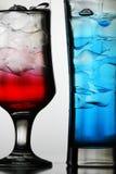 Rote und blaue Cocktails Stockfotografie