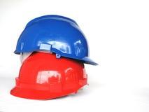 Rote und blaue Hardhats Stockfotografie