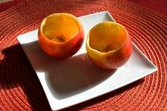Rote und gelbe Äpfel gefüllt mit Schokolade Stockbild