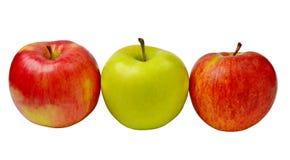 Rote und grüne Äpfel getrennt Stockbild