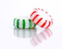 Rote und grüne Pfefferminz-Süßigkeit Stockfotos