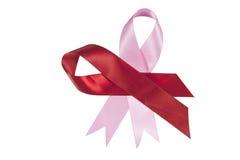 Rote und rosa Bänder zur Unterstützung der Aids und des Brustkrebses Awaren Lizenzfreies Stockfoto