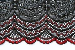 Rote und schwarze Blumen schnüren sich materiellen Beschaffenheitsmakroschuß Lizenzfreie Stockbilder