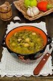 Rote und schwarze Linsen der Suppe, Kichererbsen Stockfotografie