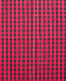 Rote und schwarze Tischdecke. Stockbilder
