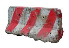 Rote und weiße Betonschranken, welche die Straße blocken. Lizenzfreies Stockbild