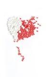 Rote und weiße Korne Lizenzfreies Stockfoto