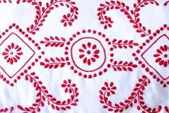 Rote und weiße Näharbeit Stockfoto
