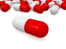 Rote und weiße Pillen Stockbild