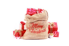Rote und weiße themenorientierte Santa Gift Sack Stockbild
