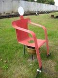 Rote ungewöhnliche Toilette Lizenzfreies Stockbild