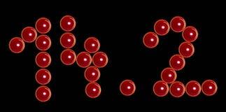 Rote Valentinsgrußkerzen als Datum 14 2 lizenzfreie stockfotografie