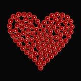 Rote Valentinsgrußkerzen als Herz am Schwarzen stockfotos