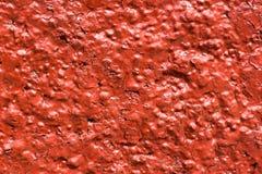 Rote Wand mit dekorativem Gips Lizenzfreie Stockbilder