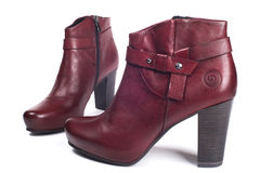 Rote weibliche Stiefel Stockfotos