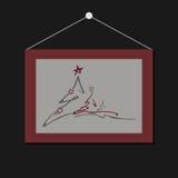 Rote Weihnachtsbaumkarte auf der Wand Stockfoto