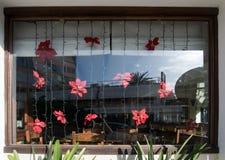 Rote Weihnachtsblumen-Lichtkette Lizenzfreie Stockfotografie