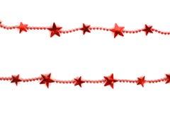 Rote Weihnachtsgirlande Lizenzfreie Stockfotos