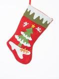 Rote Weihnachtssocke mit schönen decrations Lizenzfreie Stockbilder