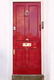 Rote Wohntür lizenzfreies stockbild