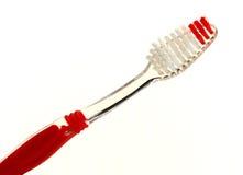 Rote Zahnbürste stockbilder