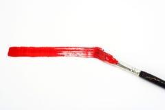 Rote Zeile und Pinsel Stockfotografie