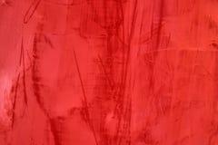 Rote Zementwandbeschaffenheit mit Farbe befleckt, roter abstrakter Hintergrund stockfoto
