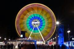 Rotella di Ferris ad illuminazione di notte Immagine Stock