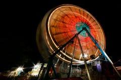 Rotella di Ferris alla notte Fotografia Stock